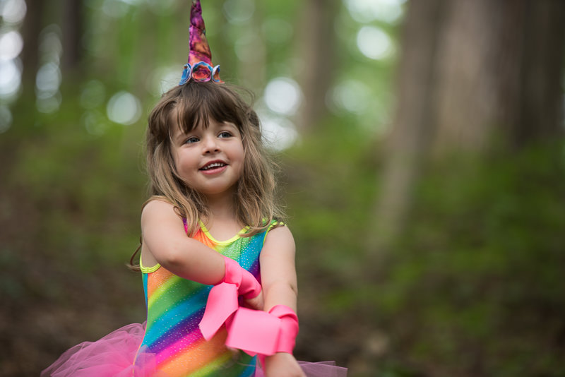 young girl dressed as a rainbow unicorn, Northville Child Photographer