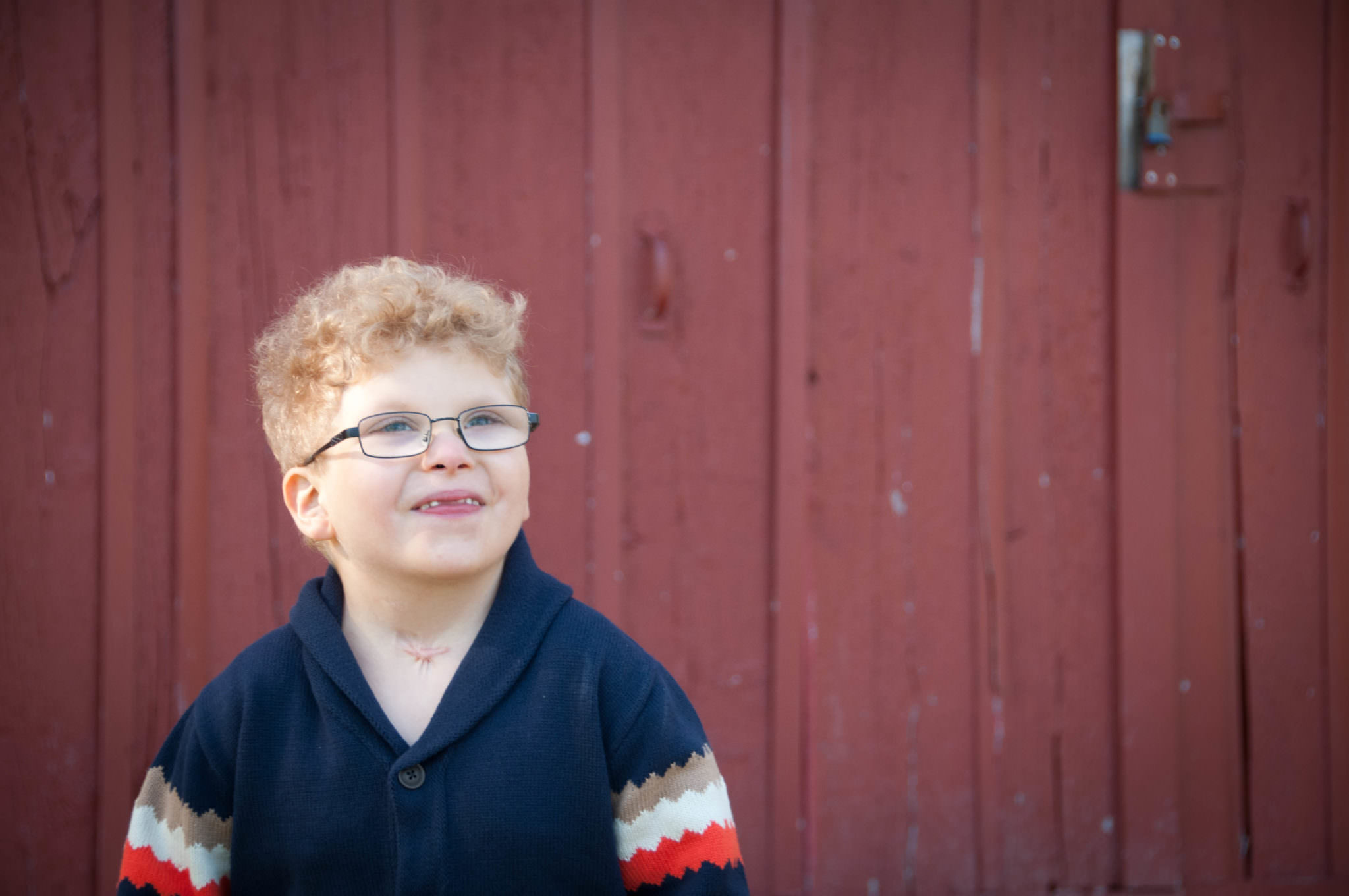 Young boy in front of barn, Metro Detroit Professional Photography