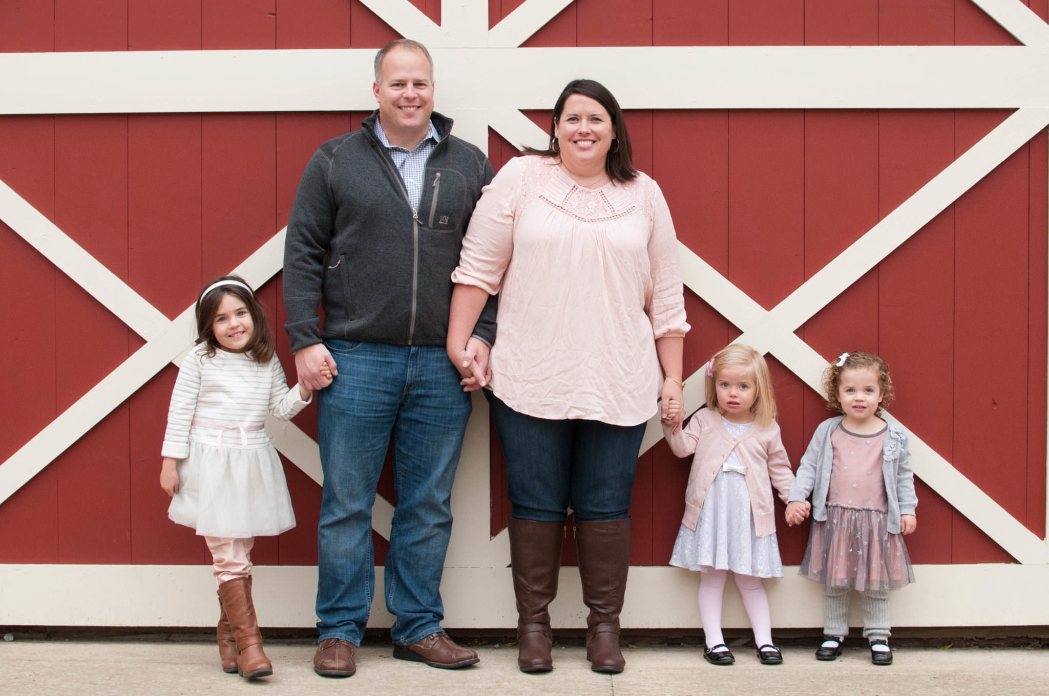 Family of five standing at a barn, South Lyon Family Photographer