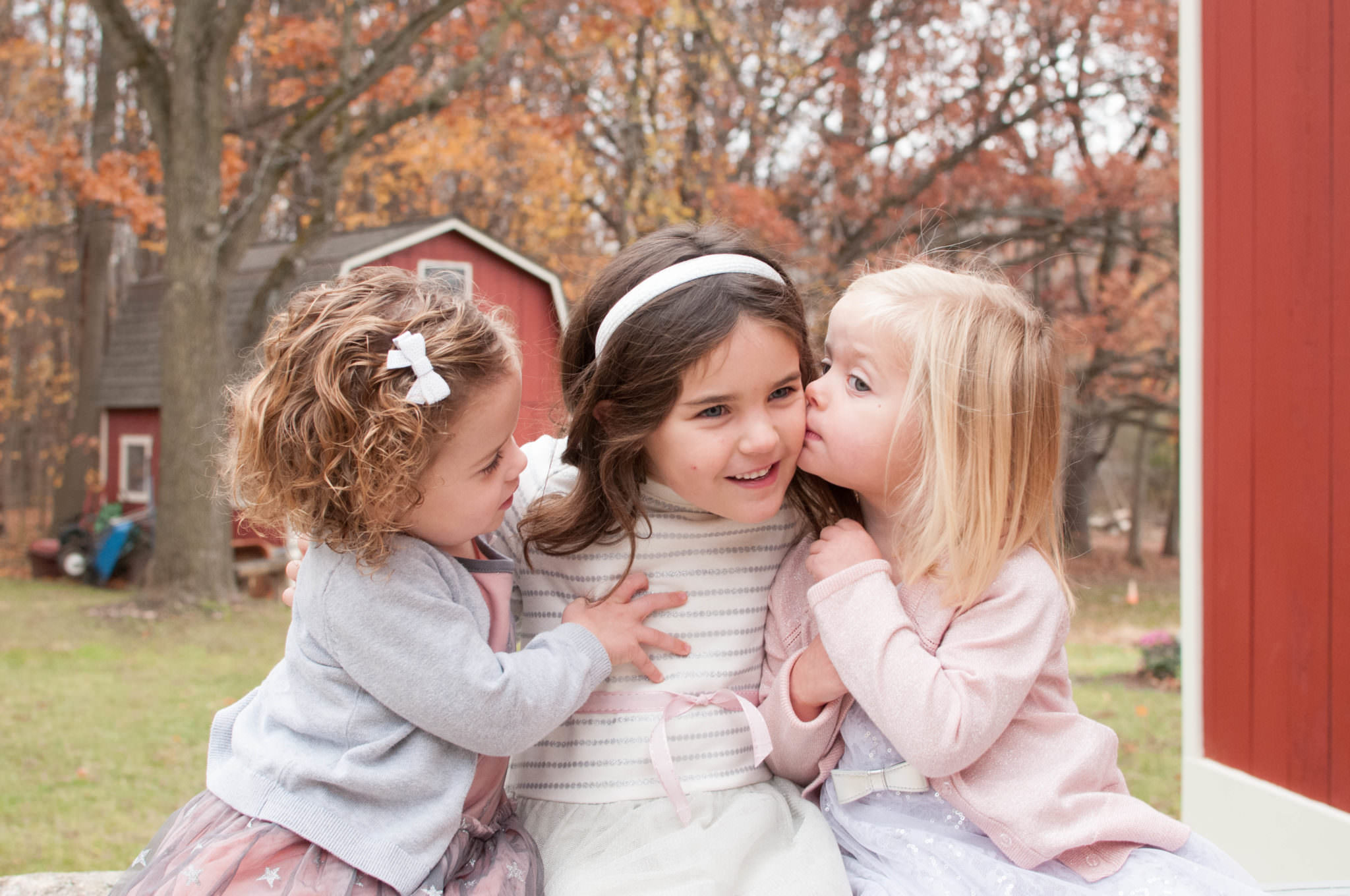Three sisters hugging at the park, South Lyon Child Photographer, Metro Detroit Child Photography