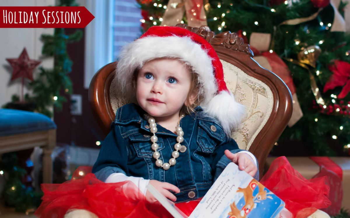 young girl in Santa hat, Metro Detroit Holiday Photography