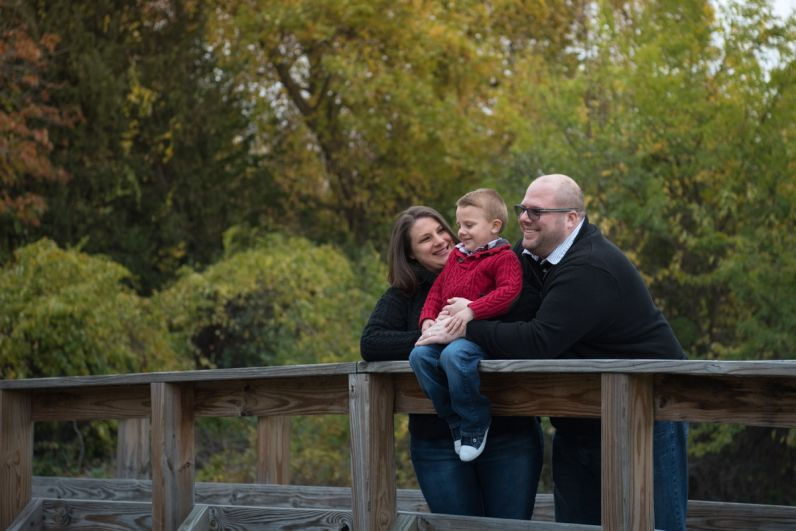 sweater wearing family on a bridge, South Lyon Family Photographer