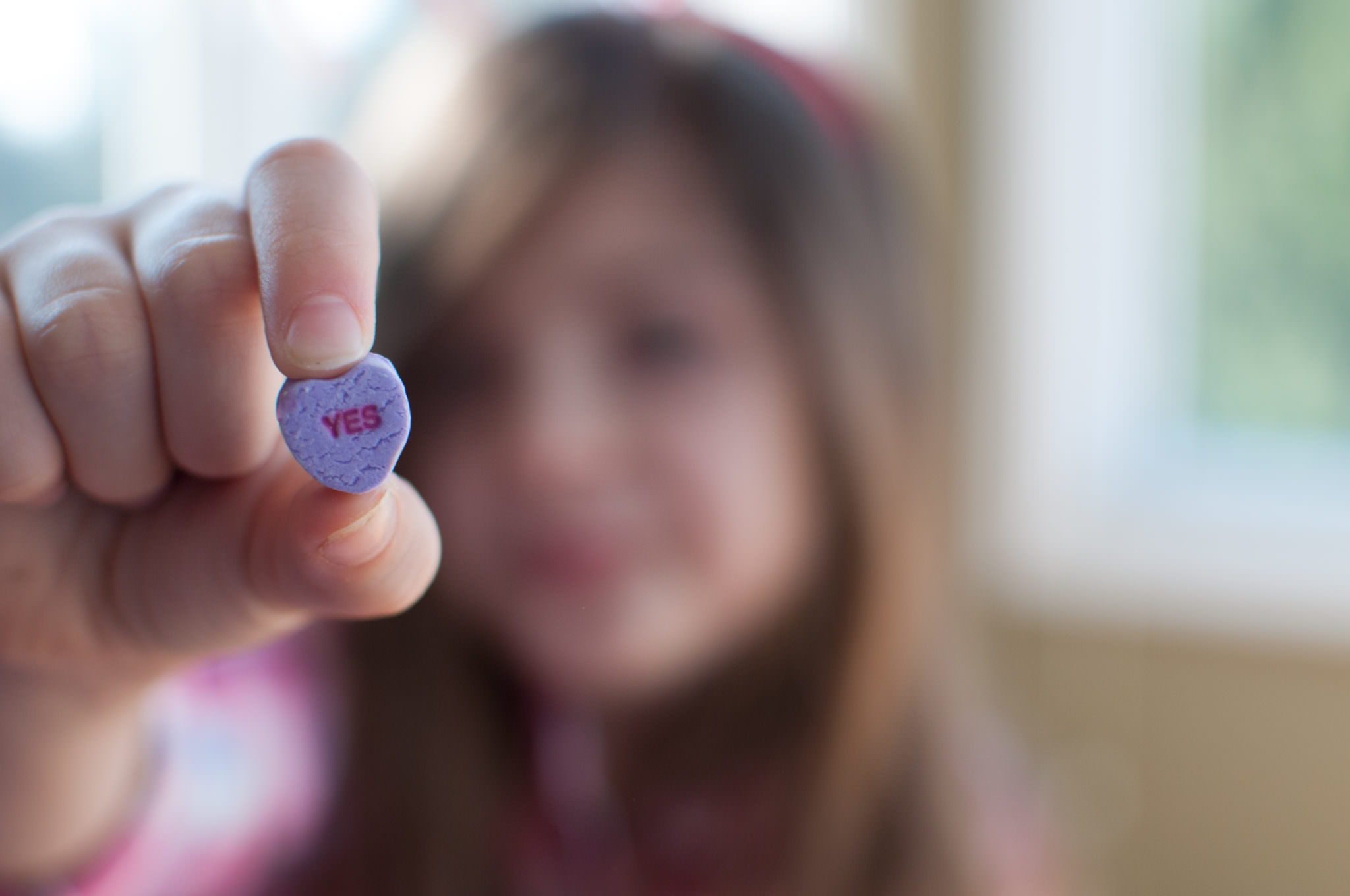 Girl holding Yes Conversation Heart, Valentine's Day Photography