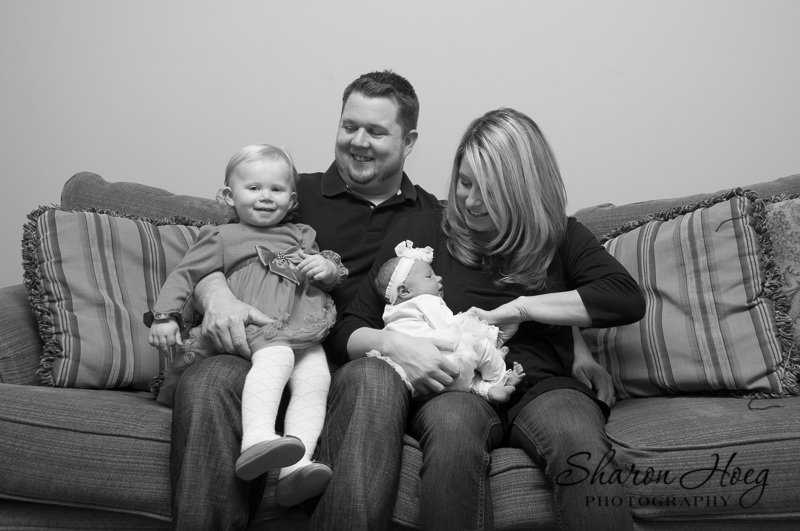New family sitting on couch, South Lyon Family Photographer