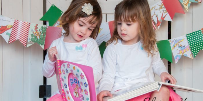 Twin girls reading books together, Plymouth Child Photography