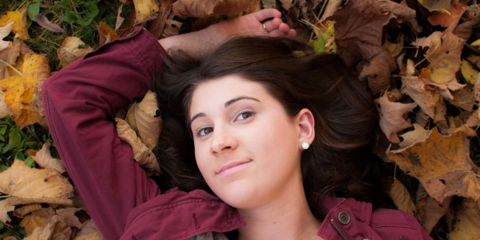 beauty shot of girl laying in the leaves, Plymouth Senior Photographer