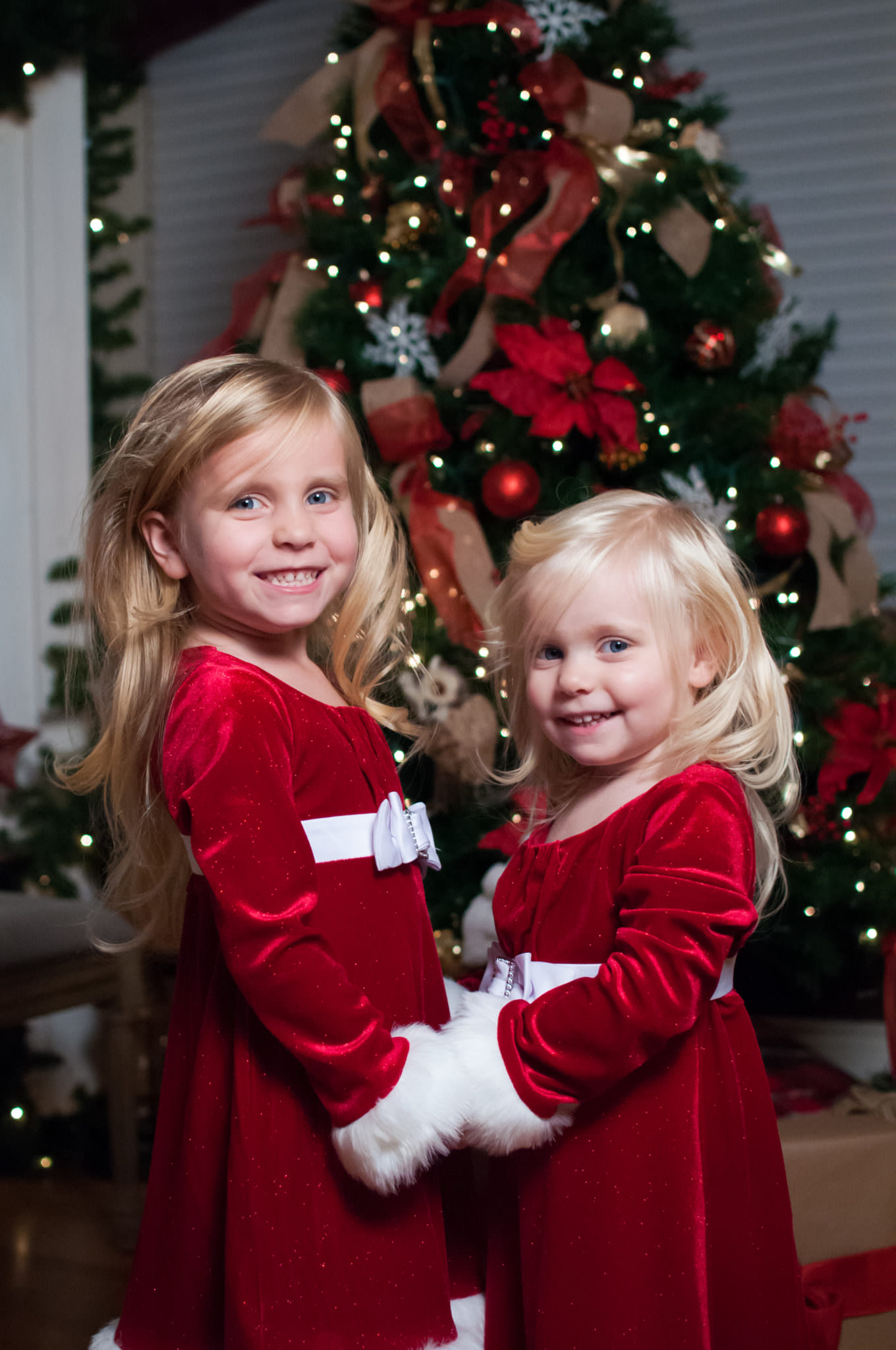 Two sisters by the Christmas tree, Plymouth Holiday Mini Sessions