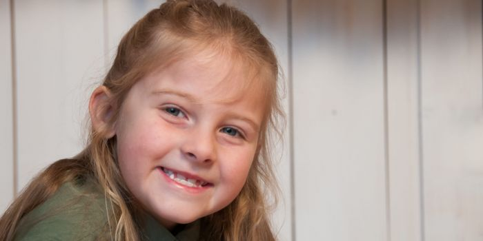 first grader smiling at camera, Northville Child Photography