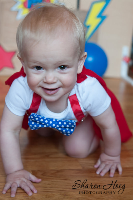 one-year-old crawling towards camera smiling, South Lyon Child Photography
