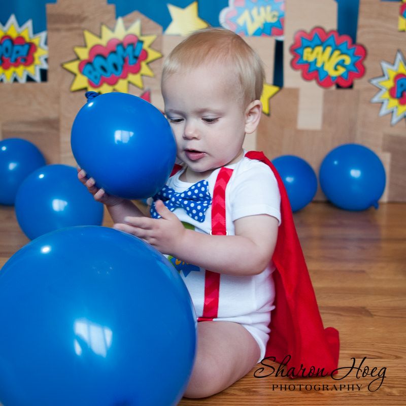 one year old super hero with balloons, Livonia Baby Photographer