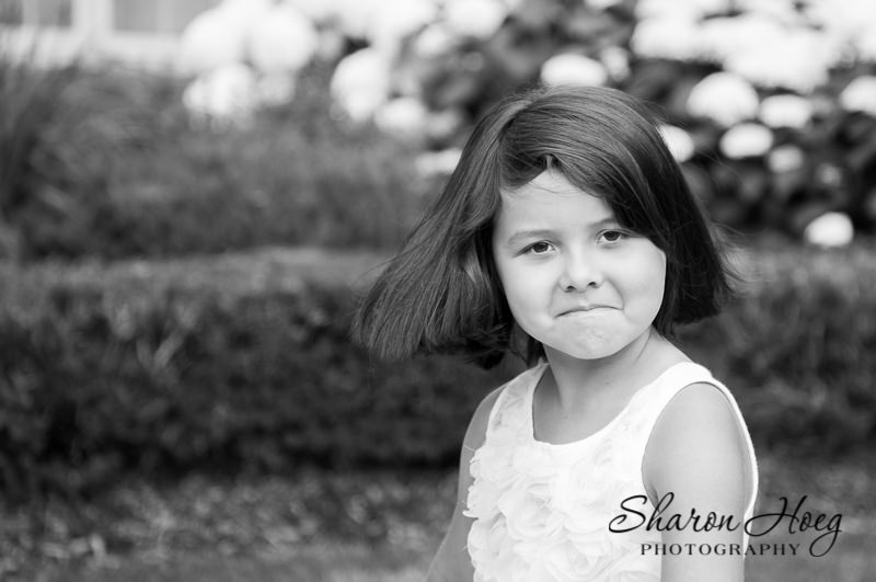 young girl making grumpy face, Northville Child Photographer