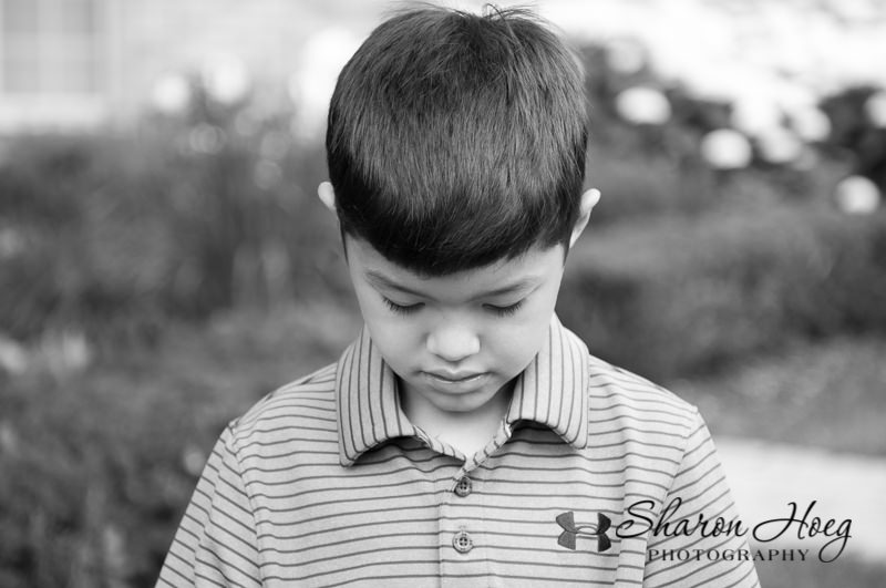 black and white photograph of young boy looking down, Northville Child Portraits