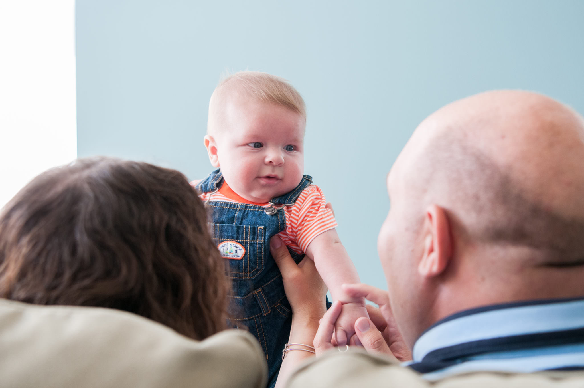 young baby boy looking at parents, Metro Detroit Baby Photographer