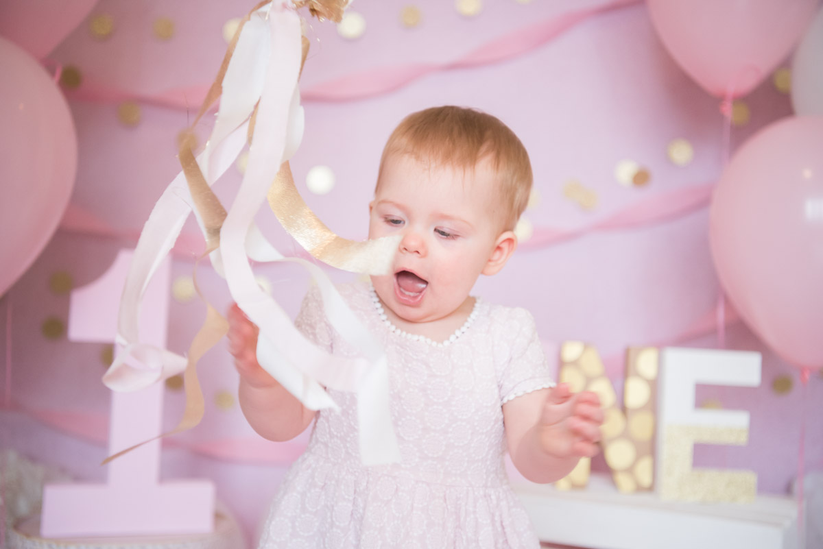 One year old girl with pink ribbon wand, Northville Photographer