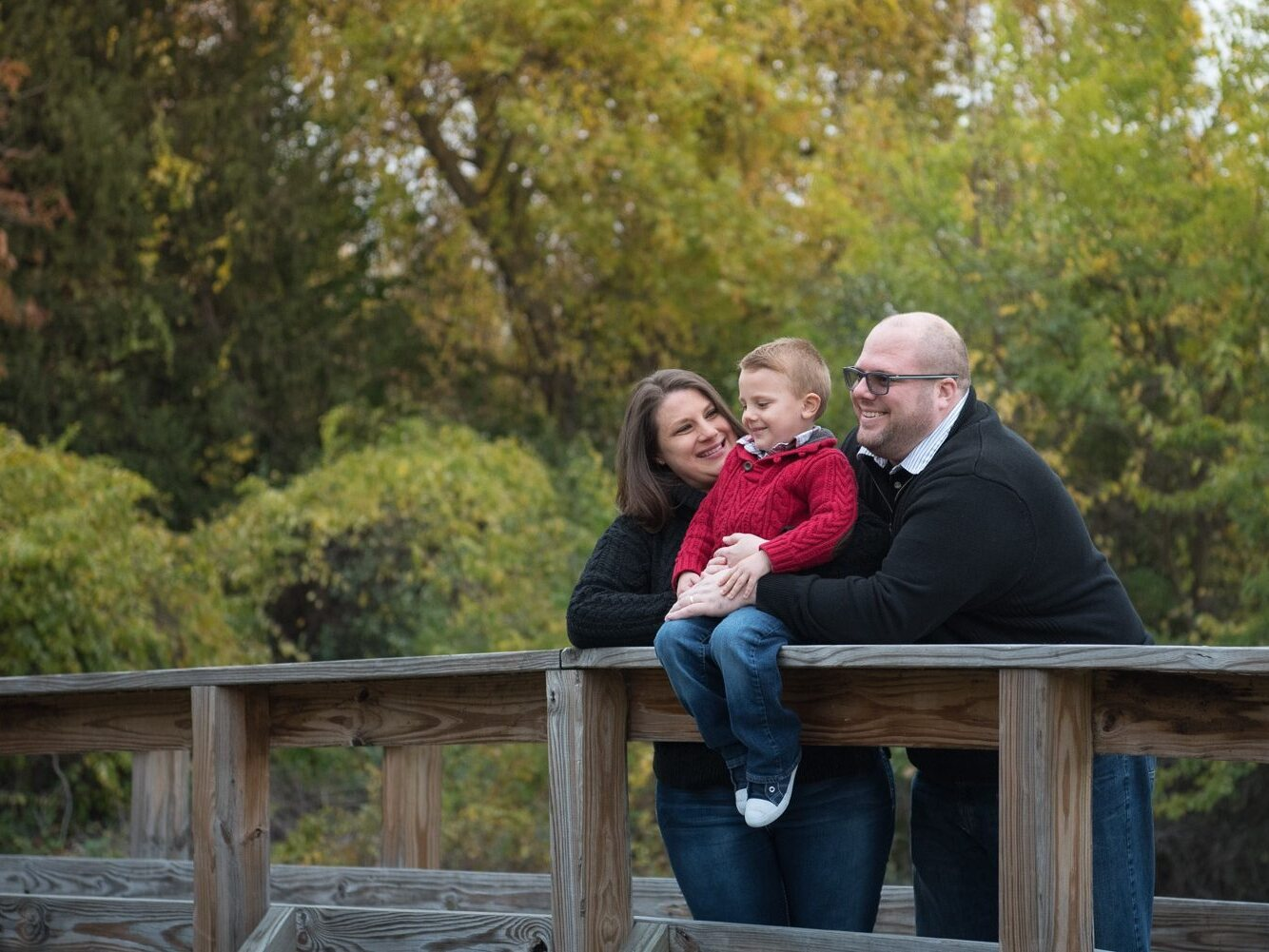 South Lyon MI Photographer, Family standing on a bridge, Michigan Photography