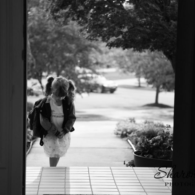 first day of school photo tips, northville photographer, black and white photograph young girl in doorway