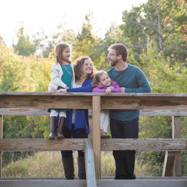 Northville MI Photographer, Family Photography, Family standing on a bridge