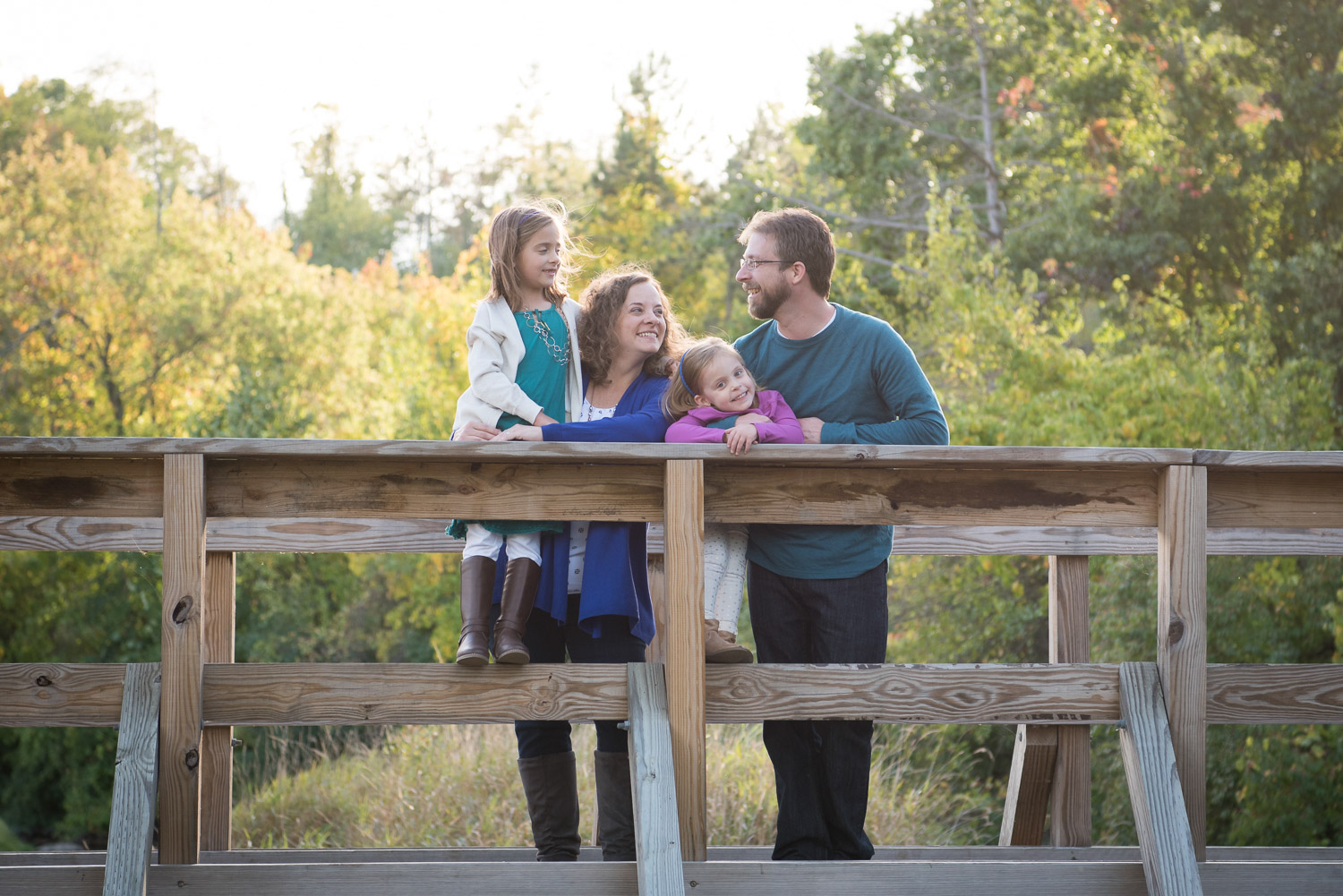 Northville MI Photographer, Family Photography, Family standing on a bridge