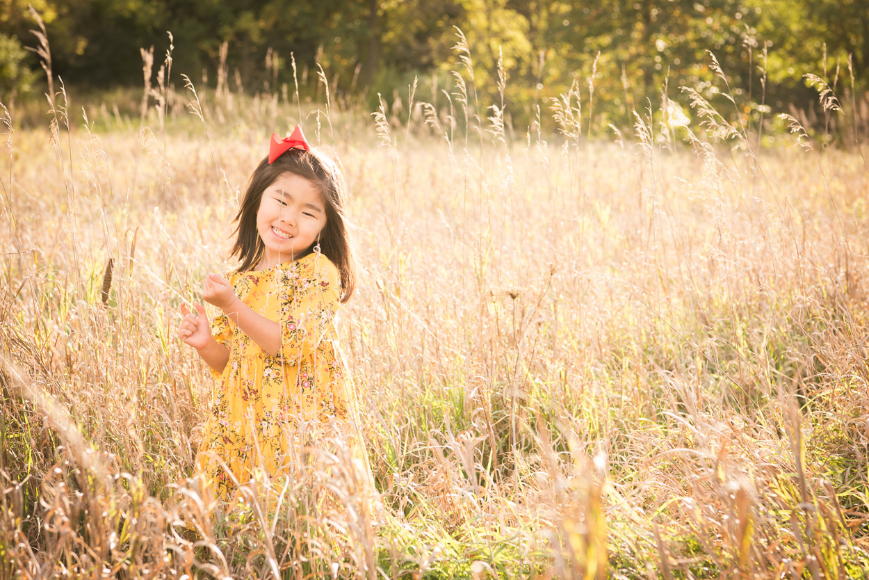 Outdoor family photographer, Northville Child Photographer, Fall Photographer, Girl standing in a field