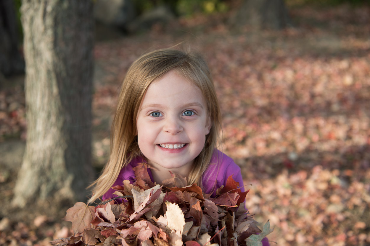 South Lyon Photographer, Girl holding leaves